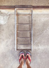 feet and iron stair.