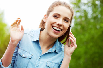 Beautiful smiling woman talking on the phone