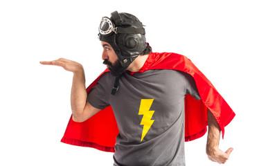 Superhero doing egypt gesture