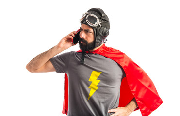 Superhero talking to mobile