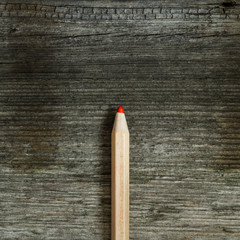 red pencil on wooden table