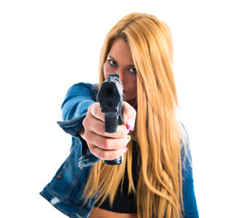 Blonde girl shooting with a pistol