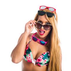 Girl wearing many sunglasses