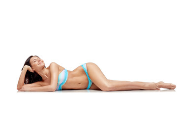 happy young woman lying in bikini swimsuit
