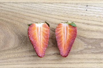 one strawberry cut in half