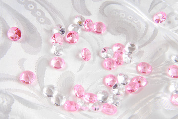 white and pink diamonds on white fabric