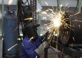 worker in constructing industry grinding metal