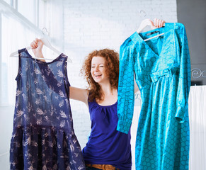 Happy young woman trying clothing dress