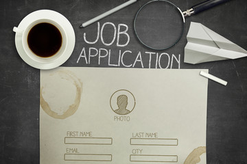 Job application concept on black blackboard with coffee cup