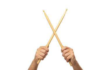 Male hands holding drum sticks.isolated backgrund