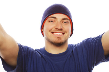 young man holding camera and making selfie