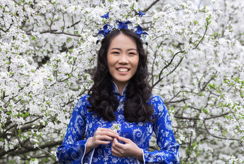 cherry blossoms background - Smiling Vietnamese girl