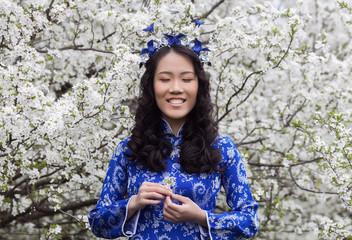 Vietnamese girl in Ao Dai Smiling