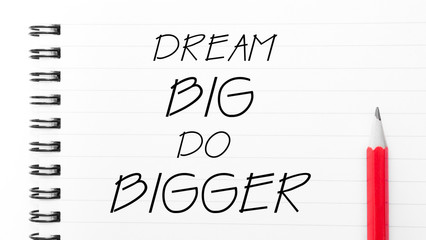 Dream Big Do Bigger  written on notebook page