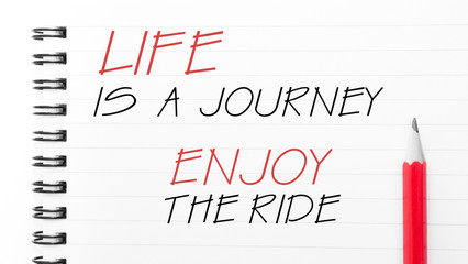 Life Is a Journey Enjoy The Ride text on notebook page
