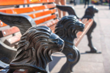 park bench with cast iron legs in the form of a lion's head