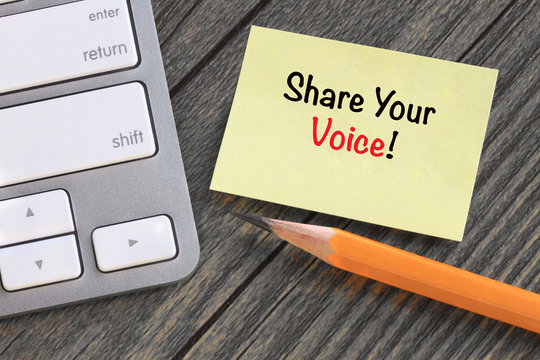 note with the message of share your voice