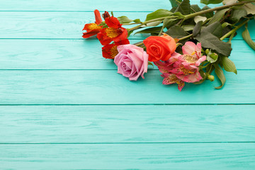 Flowers on blue wooden background. Selective focus