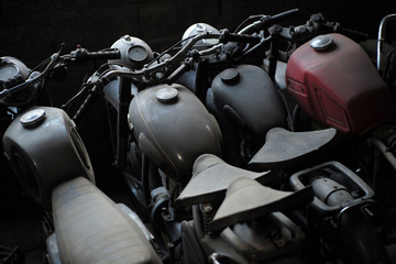 Old motorcycle in a row