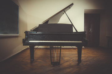 An Image of Music Room. Piano in class.