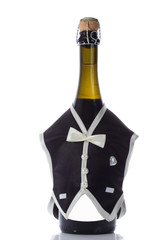 Champagne wedding bottles in suit festive decoration isolated