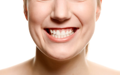 Smiling woman showing her teeth
