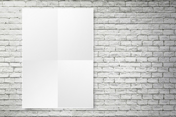 Blank folded paper poster hanging on black brick wall,Template m ...