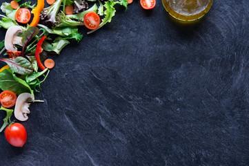 Mixed vegetables on blackboard