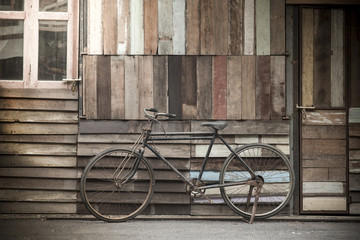 Vintage Bicycle standing near a vintage wood wall