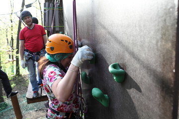 Woman climbing on the wall