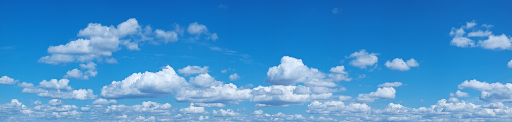 Photo sur cadre textile Ciel White heap clouds in the blue sky.