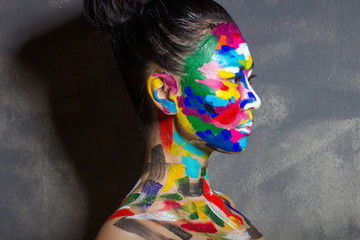 Emotions of asian woman with face art