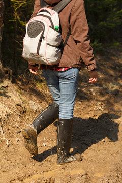 Hiker walking on mud