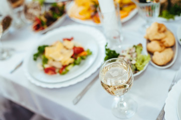 catering table set service with silverware and glass stemware at