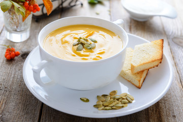 Pumpkin cream soup decorated with seeds