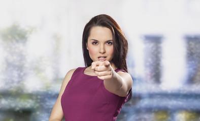 Beautiful woman pointing at camera