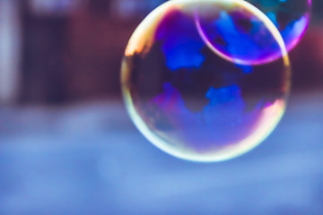 blurred natural background with soap bubble