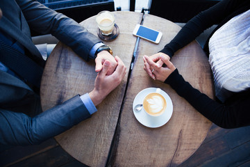 Businesswoman`s and businessman`s hands on the table