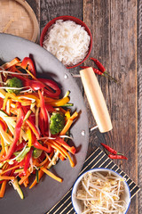 stir fry vegetables and bowl of rice