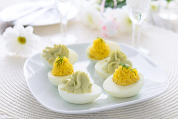 Eggs stuffed with cheese and avocado mousse