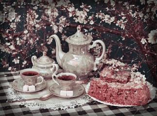 Retro still life with old tea set and blooming cherry tree
