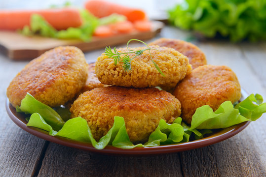 Dietetic carrots cutlets on wooden table