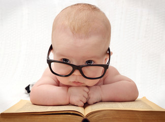 close-up of adorable baby in glasses
