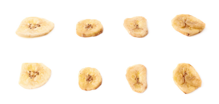 Multiple dried banana slices snacks isolated