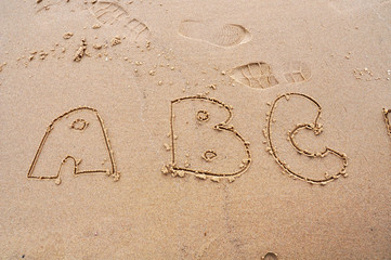 letter A, B, C on the sand
