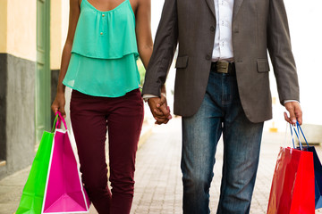 African American Couple Shopping With Bags In Panama City