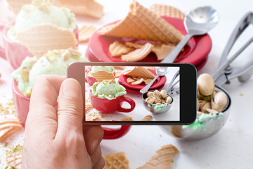 Photographing pistachios ice cream with cellphone camera