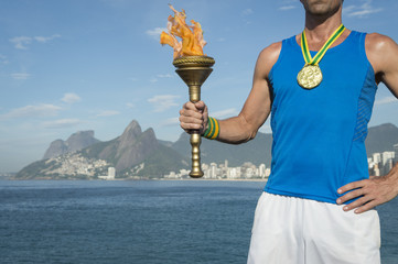 Gold Medal Athlete Holding Sport Torch Rio de Janeiro