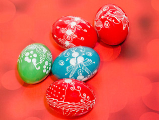 Colored romanian traditional Easter eggs, gradient background.