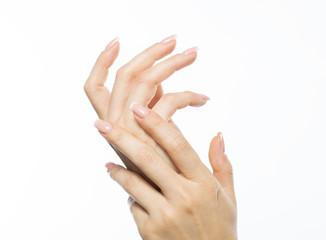 Woman rubs hand cream, makes a hand massage